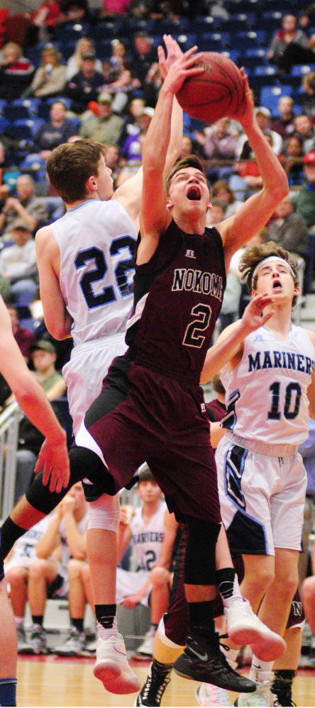 Nokomis' Joshua Smestad, right, grabs a rebound away from Oceanside's Cooper Wirkala, 22, during their Class A North semifinal game Saturday at Augusta Civic Center.