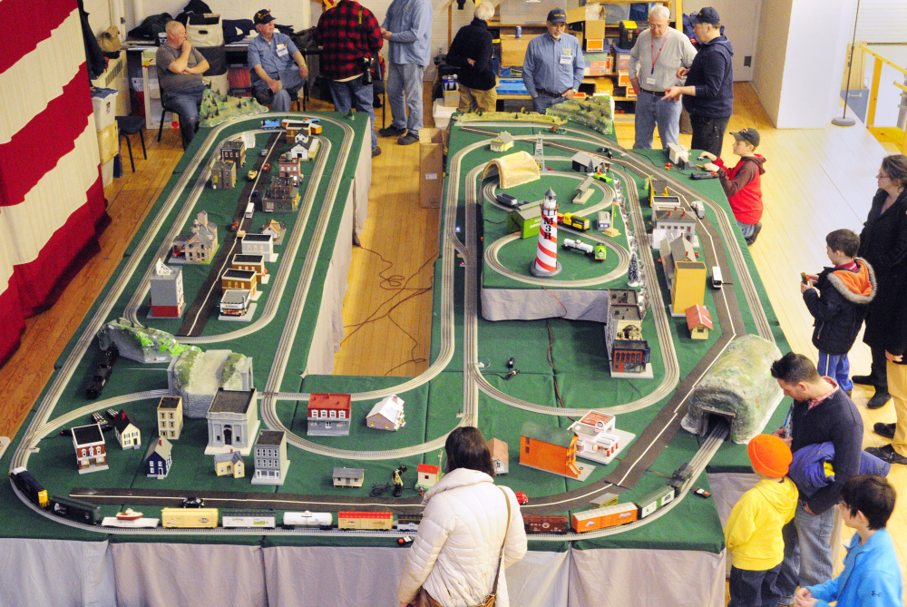People examine the Maine 3 Railers Club's model railroad layout Saturday during the 31st annual Whitefield Lions Club Model Railroad and Doll House Show at the Augusta State Armory.