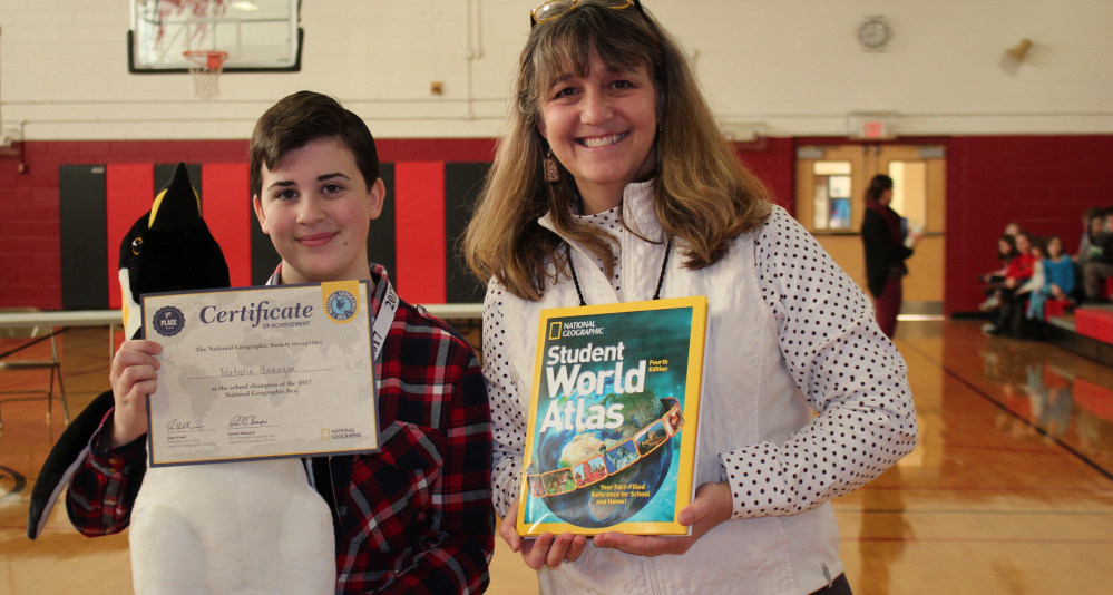 Wells Junior High eighth-grader Natalie Hanagan celebrates her National Geographic Bee win with teacher Bonnie Dill. Hanagan has been invited to the state contest in March in Farmington, for a chance to advance to the 29th Annual National Geographic Bee sponsored by the National Geographic Society in Washington, D.C.