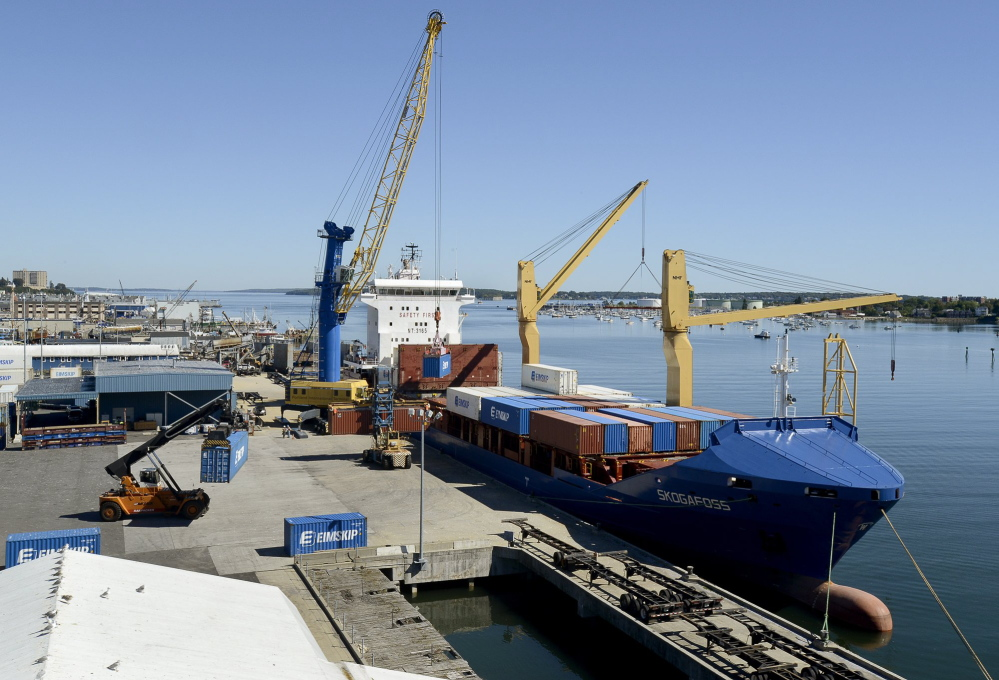 Eimskip loads containers on a ship at the International Marine Terminal in Portland. Planned upgrades at the port include the addition of a second mobile harbor crane.