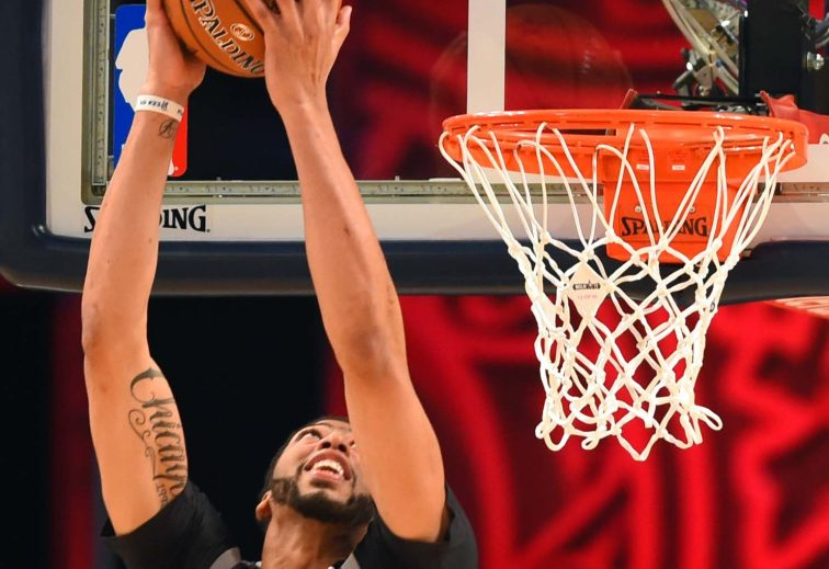 Anthony Davis throws down a reverse dunk on his way to a record-setting performance in the NBA All-Star game on Sunday in New Orleans. Davis scored 52 points, breaking the record of 42 set by Wilt Chamberlain 55 years ago.