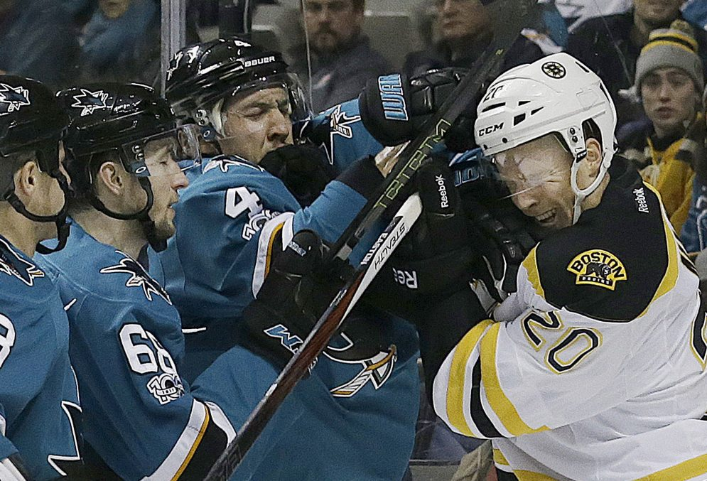 Associated Press/Jeff Chiu Boston's Riley Nash, right, and San Jose's Brenden Dillon, 4, shove each other during the second period Sunday in San Jose, Calif. Boston won in overtime, 2-1.