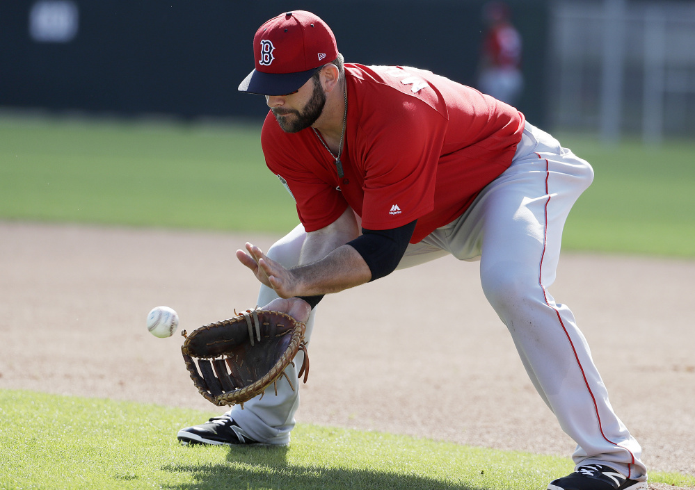 Red Sox first baseman Mitch Moreland fields a ball during a spring training workout Sunday. All eyes will be on the newcomer's bat after the retirement of David Ortiz, but the Red Sox also liked him for his glove.