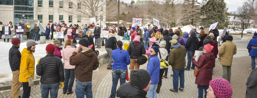 Protesters gather at the State House in Augusta on Monday – Presidents Day – to voice their objections to President Trump.