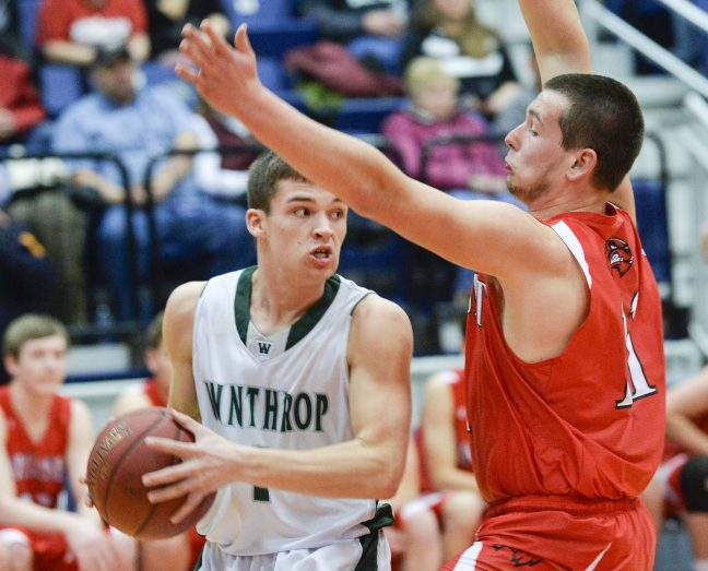 Winthrop's Bennett Brooks, left, looks to make a pass while being defended by Wiscasset's Nathanial Woodman early in their Class C South quarterfinal Monday in Augusta. Winthrop won 76-42.