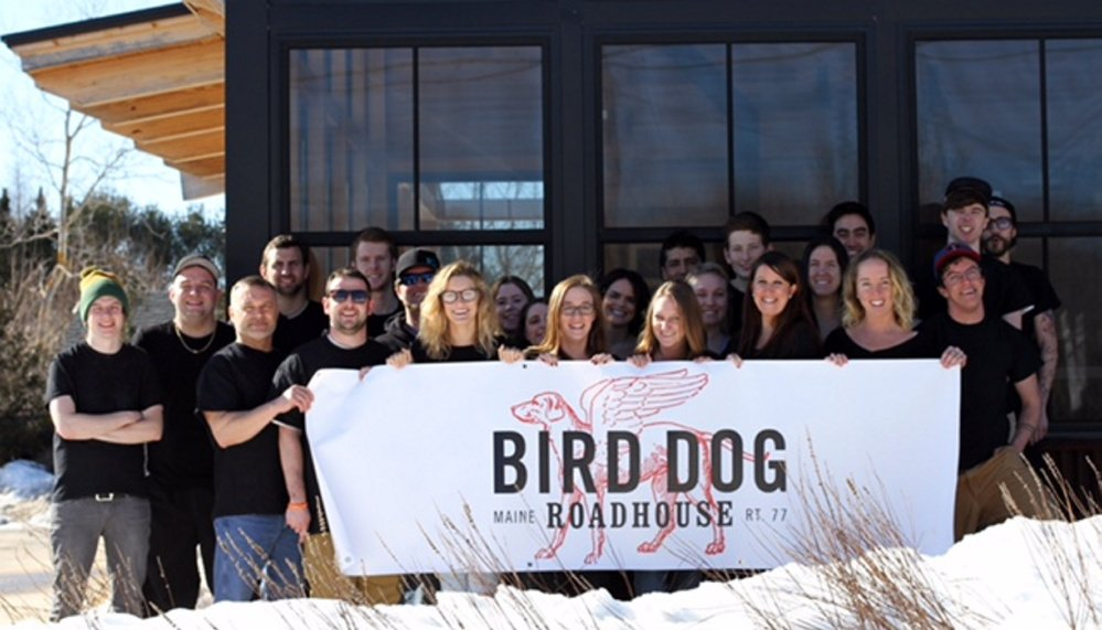 The team at the Bird Dog Roadhouse, formerly known as Rudy's of the Cape, shows off its new sign.