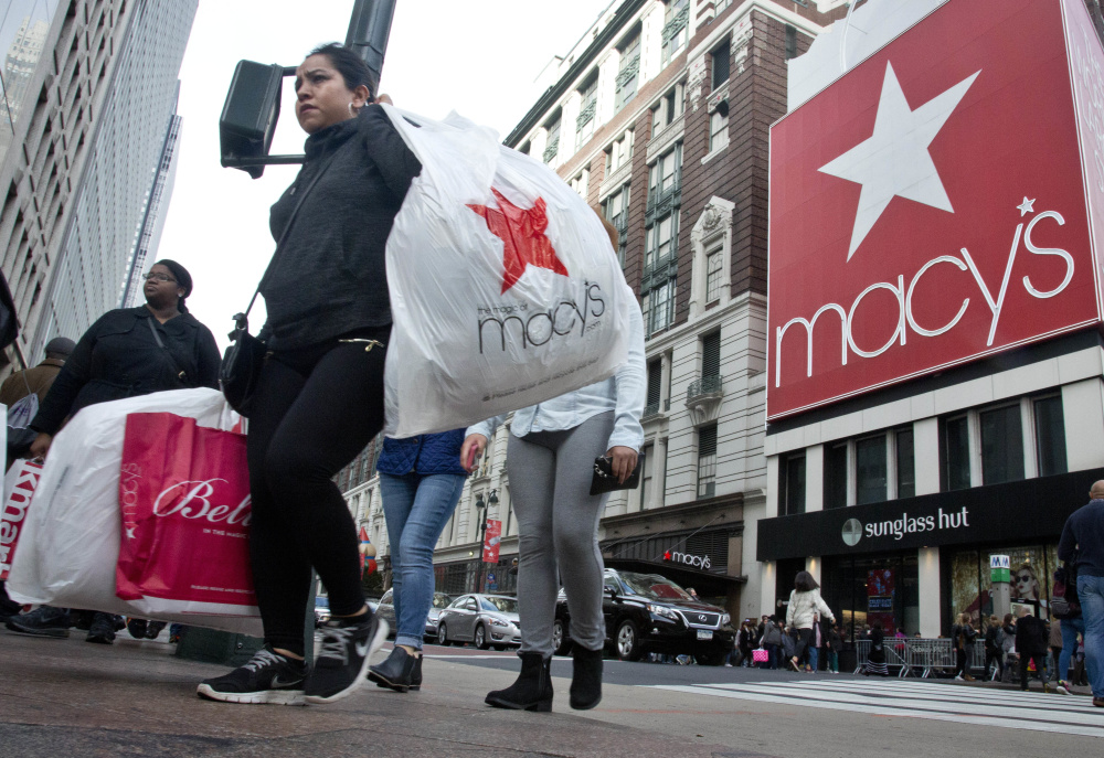 Shoppers cross near Macy's in New York City. As consumers buy more online, the nation's largest department store chain has aggressively shuttered stores while trying to adapt its brand and Web presence.