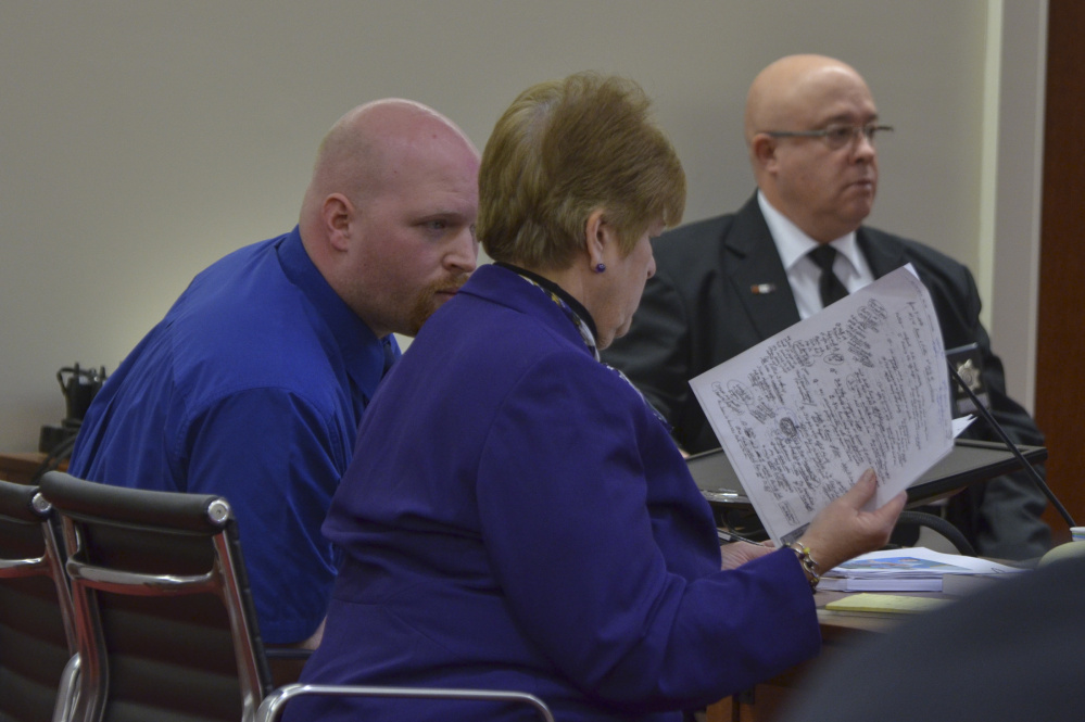 Lucas Savage, left, formerly of Clinton, confers Tuesday with his attorney, Pamela Ames, during the opening day of Savage's trial. Savage is a former co-director at a youth ministry program in Canaan and is on trial on one count of unlawful sexual contact.