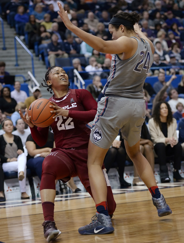 Tanaya Atkinson of Temple finds little room against Napheesa Collier of Connecticut during the first half of UConn's 90-45 victory Wednesday night in Hartford, Connecticut.