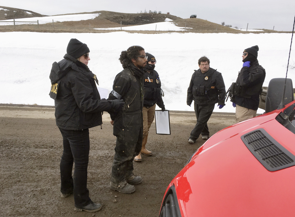 Authorities arrest one of the last remaining holdouts from the now-closed Dakota Access pipeline protest camp in southern North Dakota near Cannon Ball on Thursday. Police made about several dozen arrests, and declared the camp cleared.