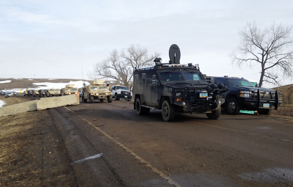 Law enforcement vehicles arrive at the closed Dakota Access pipeline protest camp near Cannon Ball, N.D., on Thursday, where dozens of people remained. Most protesters left peacefully Wednesday.