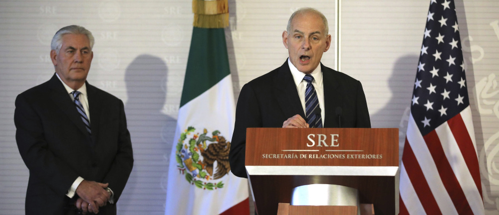 Homeland Security Secretary John Kelly, right, accompanied by Secretary of State Rex Tillerson, speaks at the Mexican Ministry of Foreign Affairs in Mexico City, Mexico, on Thursday.