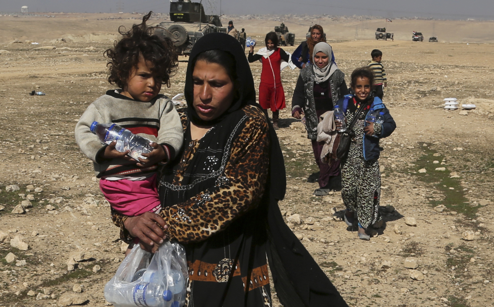 Displaced Iraqis flee their homes during fighting between Iraqi special forces and Islamic State militants on the western side of Mosul, Iraq, on Thursday.