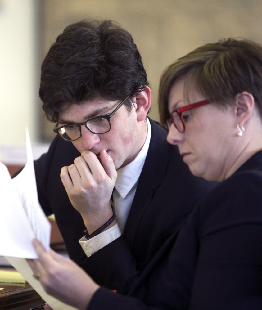 Owen Labrie and his attorney look over documents during the hearing in Concord, N.H., on whether Labrie should be granted a retrial.