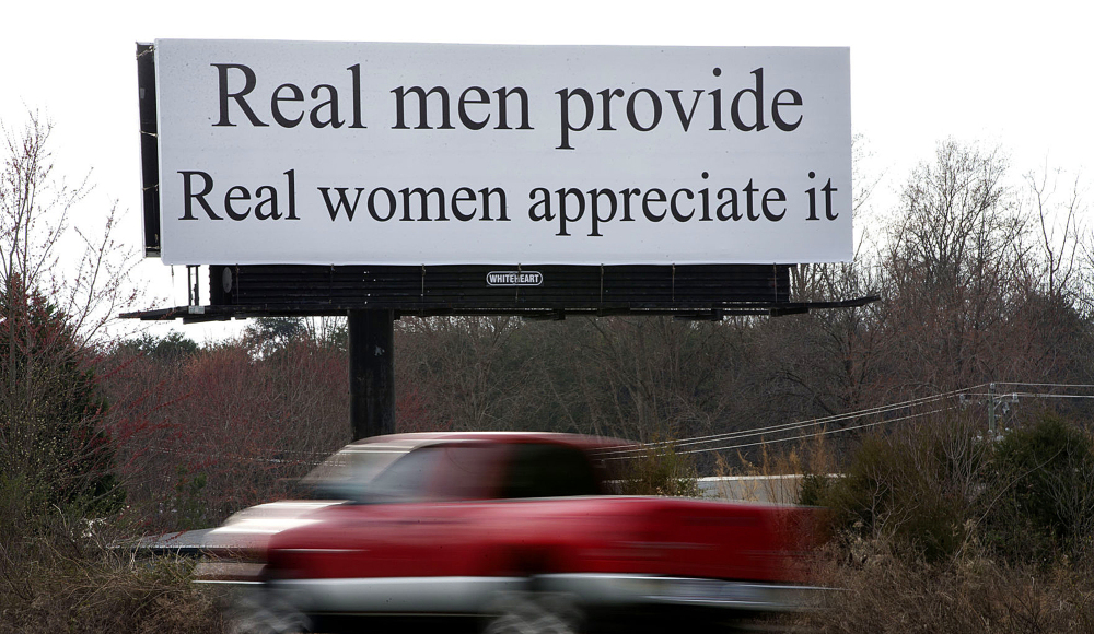 "The billboard between Winston-Salem and Greensboro reads, ""Real men provide. Real women appreciate it."" Women are planning to protest the message Sunday."