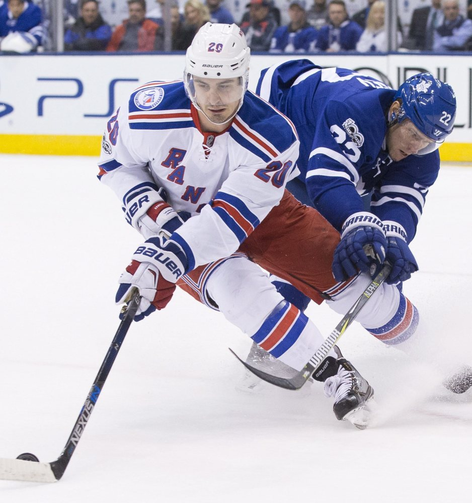 New York Rangers left wing Chris Kreider turns away from Toronto Maple Leafs defenseman Nikita Zaitsev during the first period of Thursday night's matchup of the two Eastern Conference teams in Toronto. The Rangers won, 2-1.
