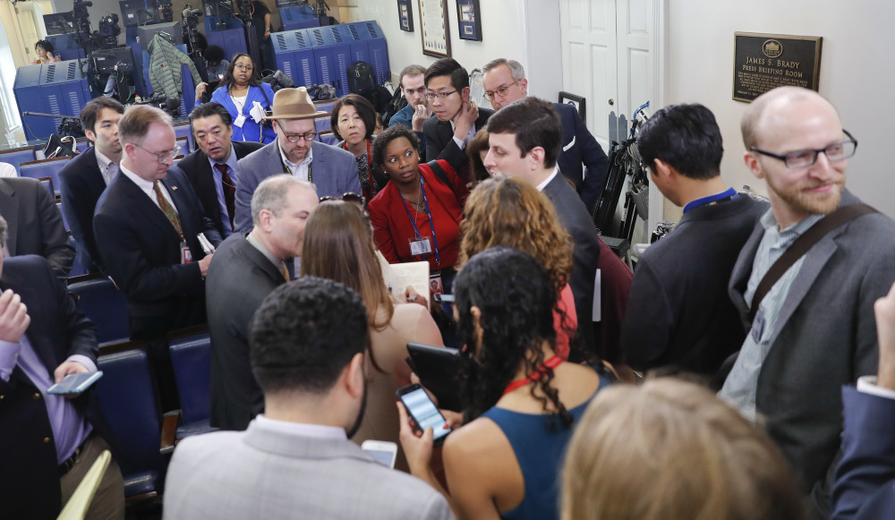 Reporters line up for a briefing in press secretary Sean Spicer's office at the White House on Friday. The White House held an off-camera briefing in Spicer's office, selecting who could attend.