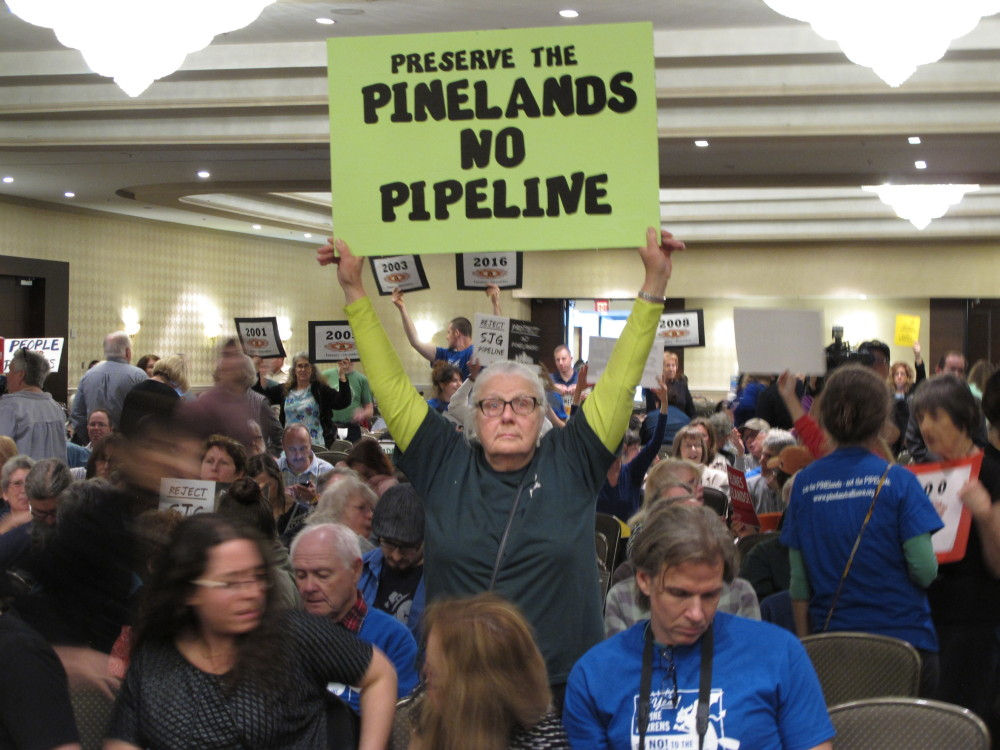 Opponents of a proposed natural gas line that would run through New Jersey's federally protected Pinelands reserve gather inside a hotel in Cherry Hill, N.J., on Friday before a Pinelands Commission meeting at which the proposal was approved.