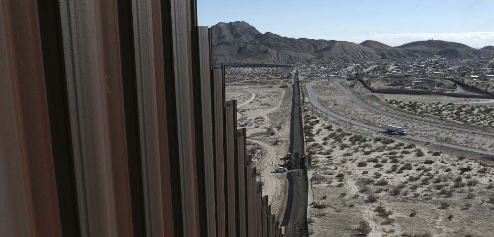 the Mexico-US border fence, on the Mexican side, separating the towns of Anapra, Mexico and Sunland Park, New Mexico, Wednesday, Jan. 25, 2017.  U.S. President Donald Trump will direct the Homeland Security Department to start building a wall at the Mexican border. (AP Photo