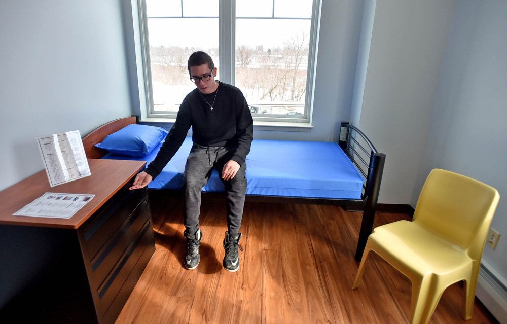 "Nicholas Turano, 20, offers a tour on Friday of an apartment he hopes to move into at the Mid-Maine Homeless Shelter in Waterville. He said he believes the shelter is a boon to ""youth who need a second shot at life."""