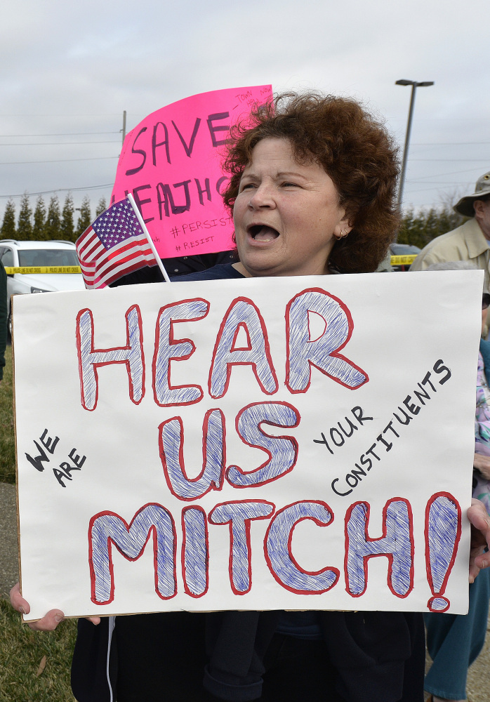 A crowd protests against Senate Majority Leader Mitch McConnell in Jeffersontown, Ky., on Wednesday.