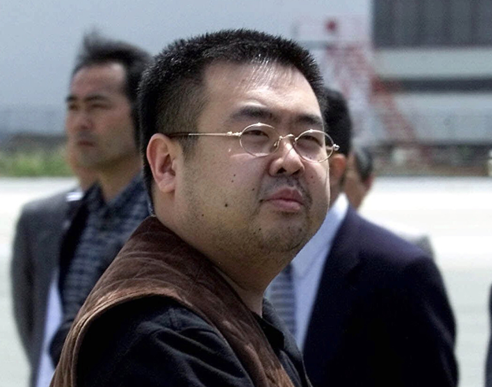 "FILE - In this May 4, 2001, file photo, a man believed to be Kim Jong Nam, the eldest son of then North Korean leader Kim Jong Il, looks at a battery of photographers as he exits a police van to board a plane to Beijing at Narita international airport in Narita, northeast of Tokyo. Police in Malaysia say the half brother of North Korea's leader who was killed in a Kuala Lumpur airport more than a week ago had a nerve agent on his eye and his face. A statement Friday, Feb. 24, 2017 from the inspector general of police said that a preliminary analysis from the Chemistry Department of Malaysia identified the agent at ""VX NERVE AGENT."" (AP Photo/Shizuo Kambayashi, File)"