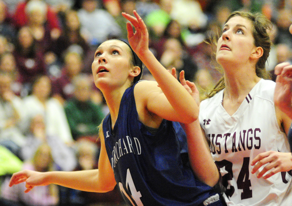Old Orchard Beach's Meghan LaPlante, left, boxes out Kaeti Butterfield of Monmouth as they go after a rebound during the Class C South championship game Saturday at the Augusta Civic Center. Monmouth won, 65-25.