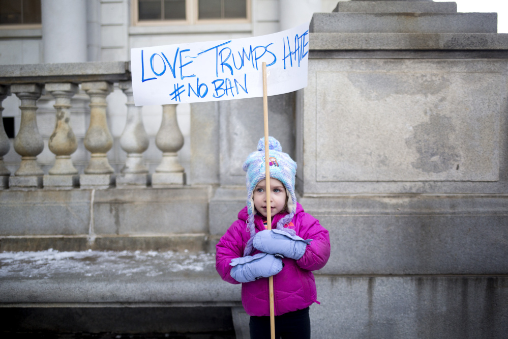 Kaye Harrington, 3, attends a rally against the president's travel ban. Her mom, Sarah Harrington, told her they were going to show their Muslim friends that we love them.