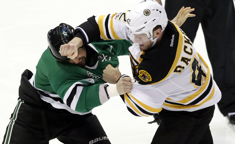Bruins right wing David Backes (42) and Dallas Stars left wing Jamie Benn (14) fight during the first period. (Associated Press/LM Otero)