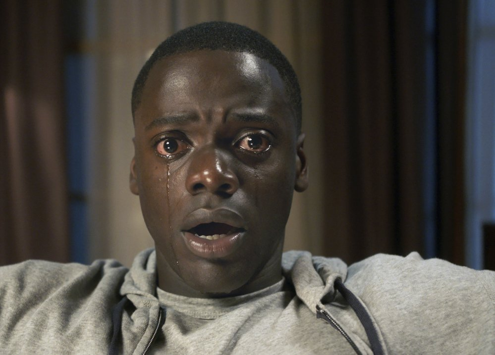 "Daniel Kaluuya performs in a scene from the movie thriller ""Get Out."""