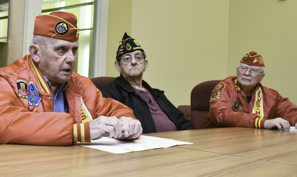 Ralph Sargent, left, and Bill Schultz, right, leaders of Marine Corps League Kennebec Valley Detachment 599, and Roger Paradis of Gardiner American Legion Post 4 discuss the continuing decline in veterans group membership.