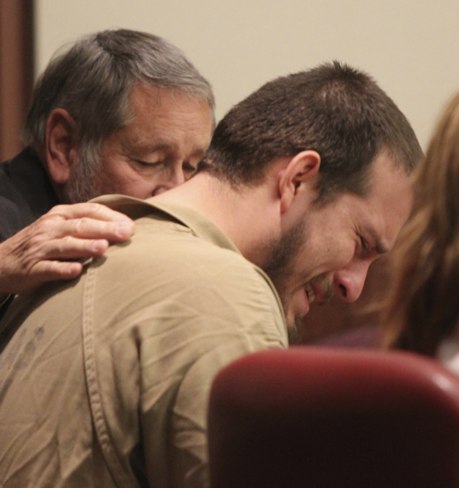 Attorney Jim Berry places his hand on the back of Jose Torres during his sentencing in Douglasville, Georgia, on Monday.
