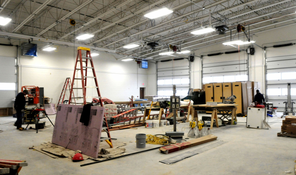 Contractors work inside the new three-bay North Station off Leighton Road in Augusta on Monday. The project with firefighter living quarters, kitchen, equipment and training rooms is scheduled to be completed next month.
