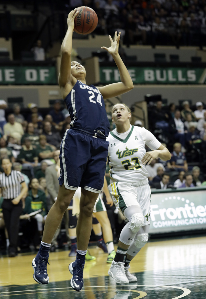 Connecticut's Napheesa Collier goes up for two of her 39 points during a 96-68 win over South Florida at Tampa, Fla., on Monday night.