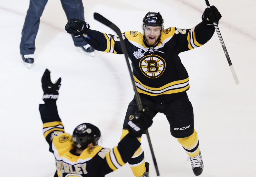 The Bruins' Daniel Paille, right, celebrates a goal by Rich Peverley against the Chicago Blackhawks in Game 4 of the 2013 Stanley Cup finals. Peverley and Chris Kelly were key trade-deadline pickups for the Bruins in 2011, when Boston won the Stanley Cup.