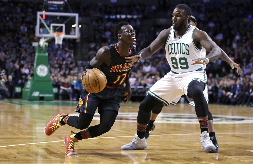 Hawks guard Dennis Schroder drives to the basket against Celtics forward Jae Crowder in the first quarter of Monday night's game in Boston. The Hawks pulled away in the second half to win easily, 114-98.