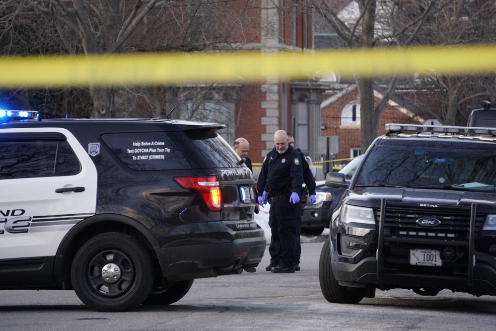 Portland police investigate the scene where Bryan K. Garcia of Scarborough died Monday on Chadwick Street in Portland.