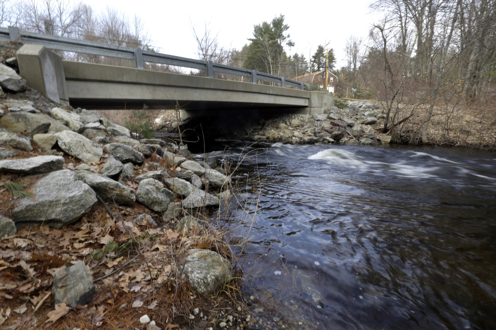 "Beaver Brook flows under a bridge closed to traffic Tuesday in Pelham, N.H. Gov. Chris Sununu pledged to invest millions of dollars in repairing roads, bridges and schools in his budget address. Some 344 municipal bridges on the state's ""red list."""