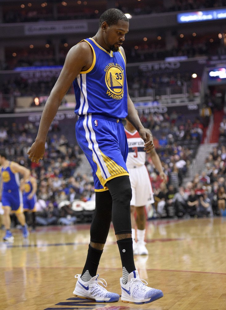 Kevin Durant of the Golden State Warriors heads to the bench after injuring his knee early in a loss Tuesday night at Washington. He will have an MRI done on the knee.