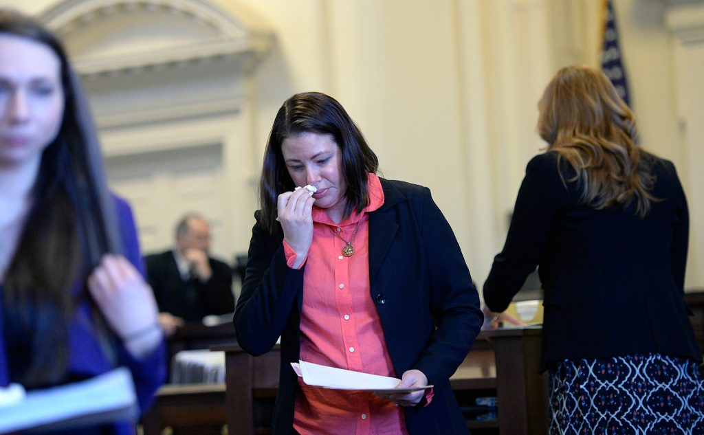 Tonya Dalbo, sister of Michael Moore, one of the two fire victims, wipes away tears after speaking at Dylan Collins' sentencing Monday.