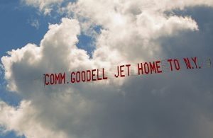 "A plane tows a banner with the message ""Comm. Goodell Jet Home to N.Y."" as it flies over Biddeford Municipal Airport on Aug. 2, 2015."