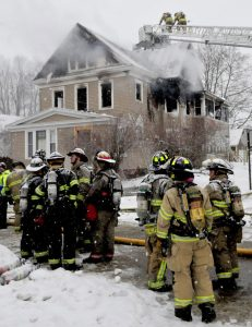 Crews were still on the scene five hours after a fire was reported at 15 Summer St. in Waterville on Wednesday. The batteries had been removed from the smoke detectors, officials say.
