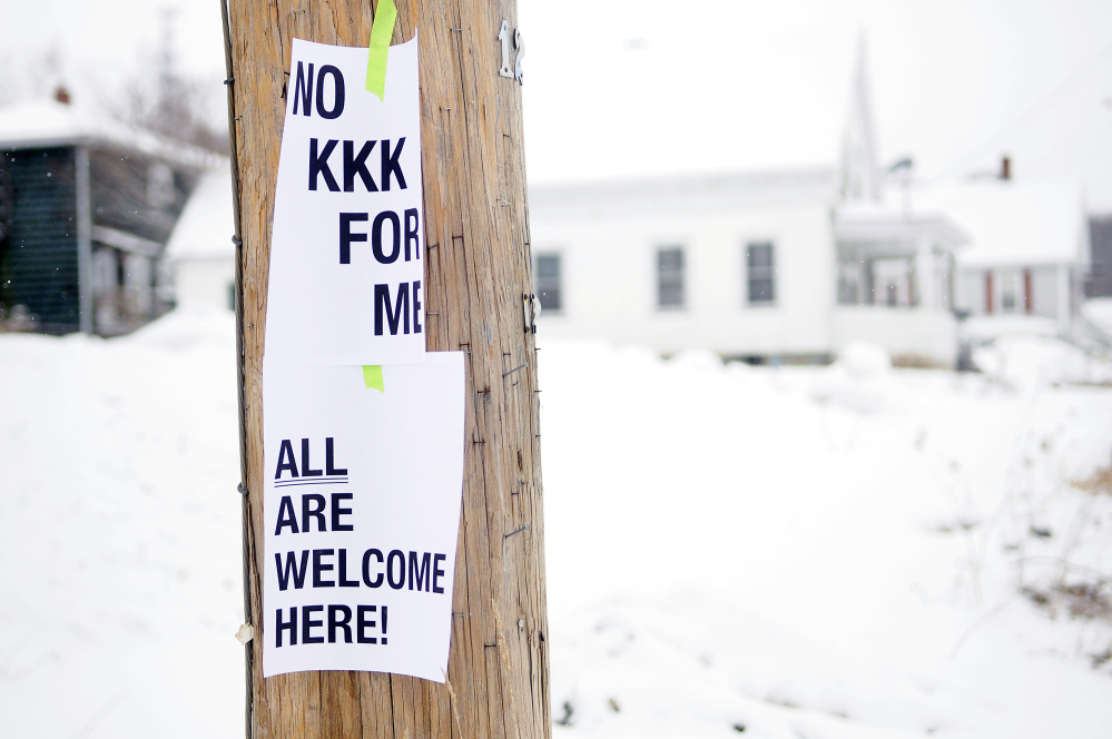 These signs hang on a utility pole on Wednesday at the corner of Cumberland and Washington streets in Augusta.