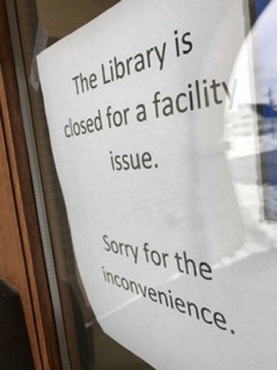 A sign alerted potential library users Wednesday that the building is closed.