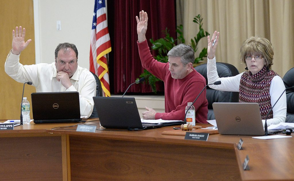 Ogunquit Select Board members, left to right, Gary Latulippe, John Daley and Barbara Dailey vote to accept Town Manager Thomas Fortier's letter of resignation Tuesday night. Board members lashed out at residents and one another during the meeting.