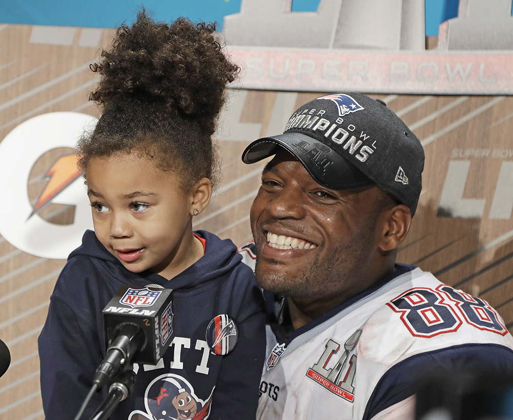 New England Patriots' Martellus Bennett appears at a news conference with his daughter Austyn Jett Rose Bennett after the team's epic Super Bowl victory Sunday in Houston.