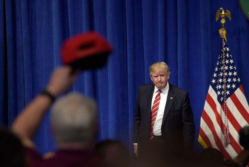 President Donald Trump finishes speaking to troops while visiting U.S. Central Command and U.S. Special Operations Command at MacDill Air Force Base in Tampa, Fla.,Monday, Feb. 6, 2017.  AP Photo/Susan Walsh)