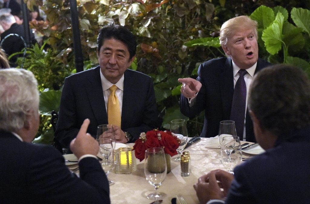 President Trump sits down to dinner with Japanese Prime Minister Shinzo Abe at Mar-a-Lago in Palm Beach, Fla., on Friday, Feb. 10.