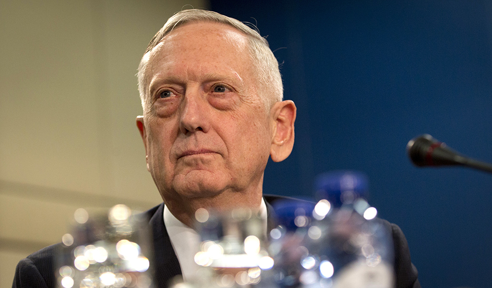 U.S. Secretary of Defense Jim Mattis waits for the start of the North Atlantic Council at NATO headquarters in Brussels Wednesday. For Mattis, the next few days will be a reassurance tour but is  also aiming to secure bigger defense spending commitments.