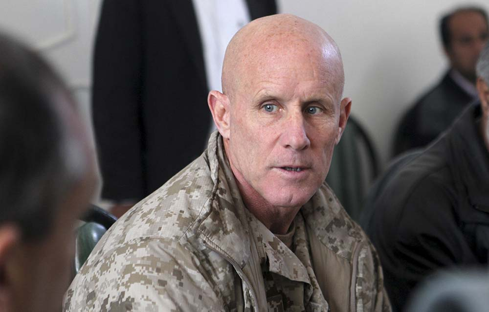 In this image provided by the U.S. Marine Corps, Vice Adm. Robert S. Harward, commanding officer of Combined Joint Interagency Task Force 435, speaks to an Afghan official during his visit to Zaranj, Afghanistan, in 2011.
